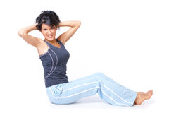 Young woman doing exercise Stock Photography