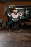 Young Woman Doing Exercise Barbell Squat Stock Photos