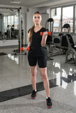 Young Woman Doing Exercise For Biceps With Dumbbells Royalty Free Stock Images