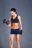 Young woman doing exercise with dumbbells Royalty Free Stock Photo