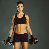 Young woman doing exercise with dumbbells Royalty Free Stock Image