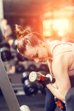 Young woman doing exercise with dumbbells in a gym Stock Photography