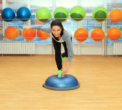 Young woman doing exercise on fit ball Royalty Free Stock Photos