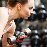 Young woman doing exercise in fitness center Royalty Free Stock Photography