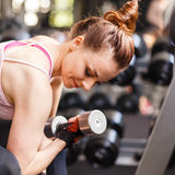Young woman doing exercise in fitness center Stock Photography