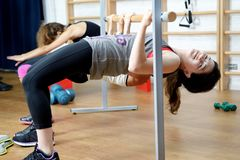 Young woman doing exercise in gym Stock Photo