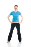 The young woman doing exercise isolated on a white Royalty Free Stock Images