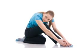 The young woman doing exercise isolated on a white Royalty Free Stock Photos