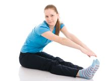 The young woman doing exercise isolated on a white Royalty Free Stock Photography