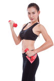 Young woman doing exercise with lifting weights Stock Photography