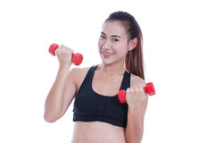 Young woman doing exercise with lifting weights Stock Photos