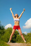 Young woman doing exercise in park Stock Images