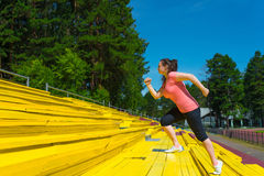 Young woman doing exercise at the stadium Royalty Free Stock Image