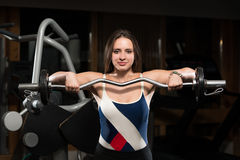 Young Woman Doing Exercise For Trapezius Royalty Free Stock Photography