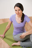 Young woman doing exercise yoga pose Stock Photo