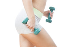 Young woman doing exercises with dumbbells Royalty Free Stock Photography