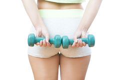 Young woman doing exercises with dumbbells Stock Photography