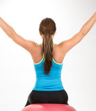 Young woman doing exercises on exercise ball Stock Photography