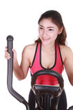Young woman doing exercises with exercise machine Royalty Free Stock Images