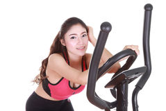 Young woman doing exercises with exercise machine Royalty Free Stock Photos