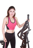 Young woman doing exercises with exercise machine Stock Photography