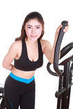 Young woman doing exercises with exercise machine Royalty Free Stock Image