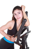 Young woman doing exercises with exercise machine Stock Photo