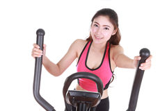 Young woman doing exercises with exercise machine Stock Photos