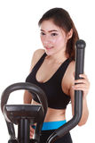 Young woman doing exercises with exercise machine Stock Image