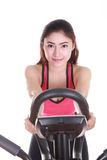 Young woman doing exercises with exercise machine Stock Images