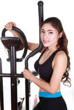Young woman doing exercises with exercise machine Royalty Free Stock Photo