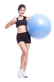 Young woman doing exercises with fitness ball Stock Photo