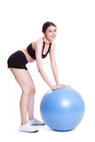 Young woman doing exercises with fitness ball Stock Photos