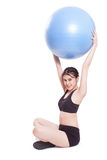 Young woman doing exercises with fitness ball Royalty Free Stock Images