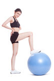 Young woman doing exercises with fitness ball Royalty Free Stock Photo