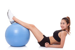 Young woman doing exercises with fitness ball. Royalty Free Stock Photos