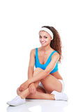 Young woman doing exercises . isolated on white background Royalty Free Stock Images