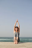 Young Woman Doing Exercises On The Beach Royalty Free Stock Photography