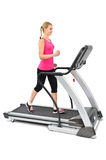 Young woman doing exercises on treadmill. On white background Royalty Free Stock Photos