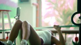 Young woman doing exercises on treadmill, with. Barbell on bench in gym. At the end of running drinking water and leaves. Set 3 clips. Fitness 1920x1080 stock footage