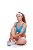Young woman doing exercises .  on white background Royalty Free Stock Photo