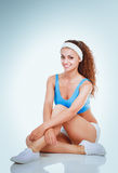 Young woman doing exercises .  on white background Royalty Free Stock Image