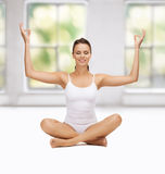Young woman doing exercises, yoga, pilates Royalty Free Stock Images