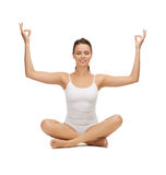 Young woman doing exercises, yoga, pilates Royalty Free Stock Photography