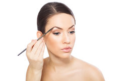 Young woman doing eyebrows Stock Photos
