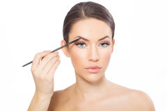 Young woman doing eyebrows Royalty Free Stock Images