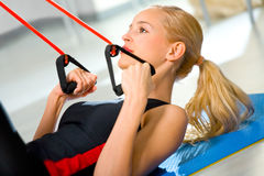 Young woman doing fitness Stock Photos