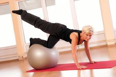 Young woman doing fitness exercise with fit ball. Stock Photography