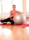 Young woman doing fitness exercise with fit ball. Stock Images