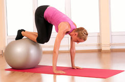 Young woman doing fitness exercise with fit ball. Stock Photo